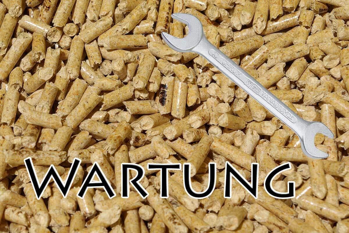 Wartung einer Pelletheizung. Schraubenschlüssel - Link zu Wartung
